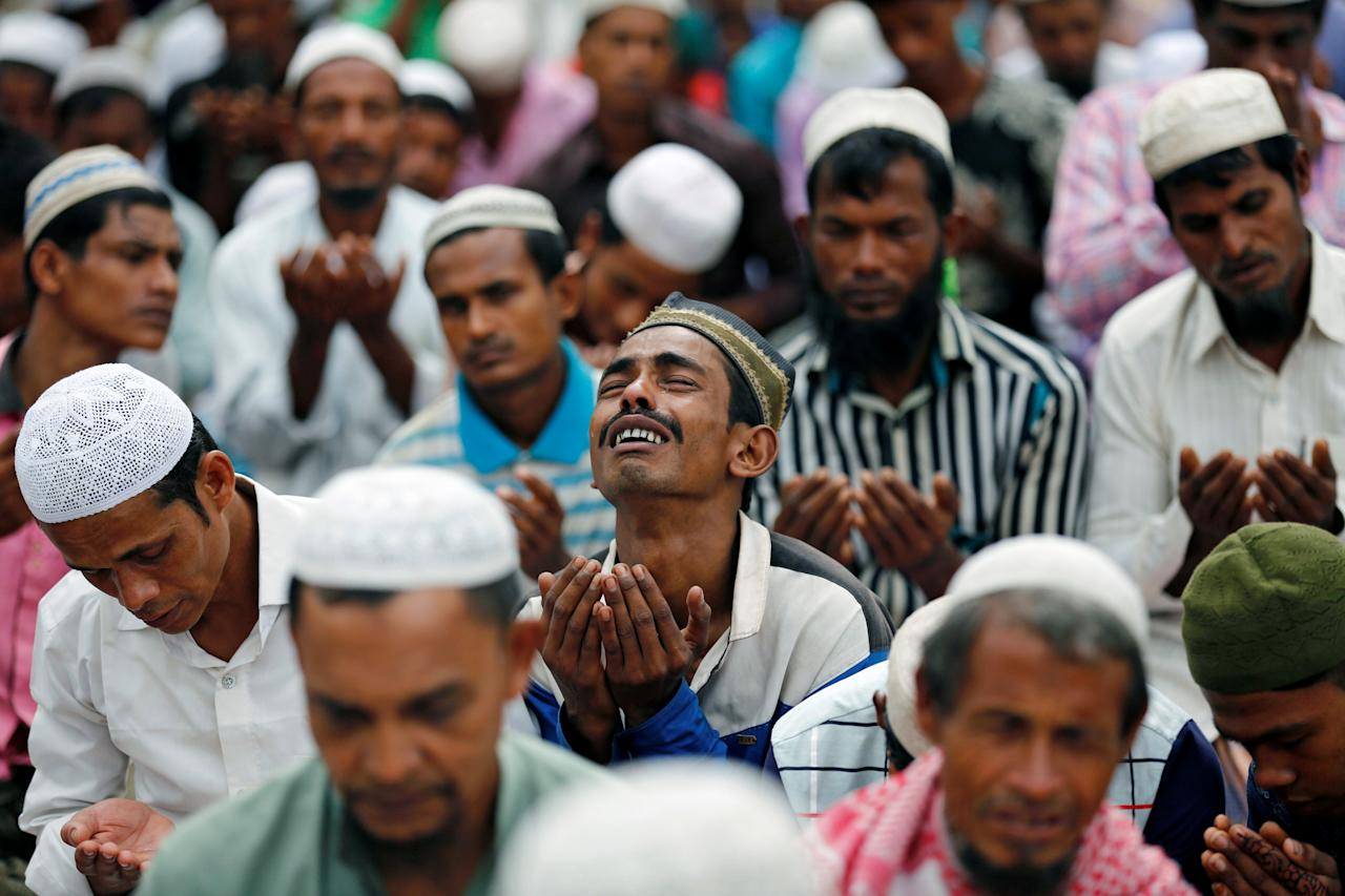<p>A Rohingya refugee man cries as he take part in Eid al-Adha prayer near the Kutupalang makeshift refugee camp, in Coxís Bazar, Bangladesh, Sept. 2, 2017. (Photo: Mohammad Ponir Hossain/Reuters) </p>