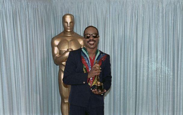 PHOTO: Stevie Wonder holds his Oscar award for the category of Best Song, March 25, 1985, (Bettmann Archive/Getty Images)