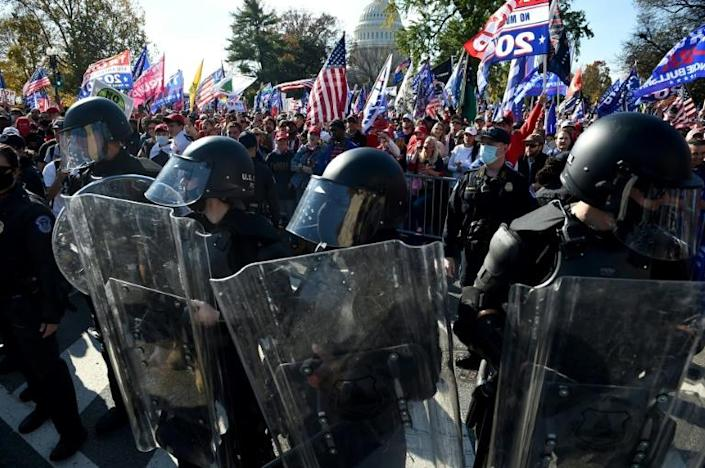 Police officers in riot gear as supporters of US President Donald Trump rally in Washington