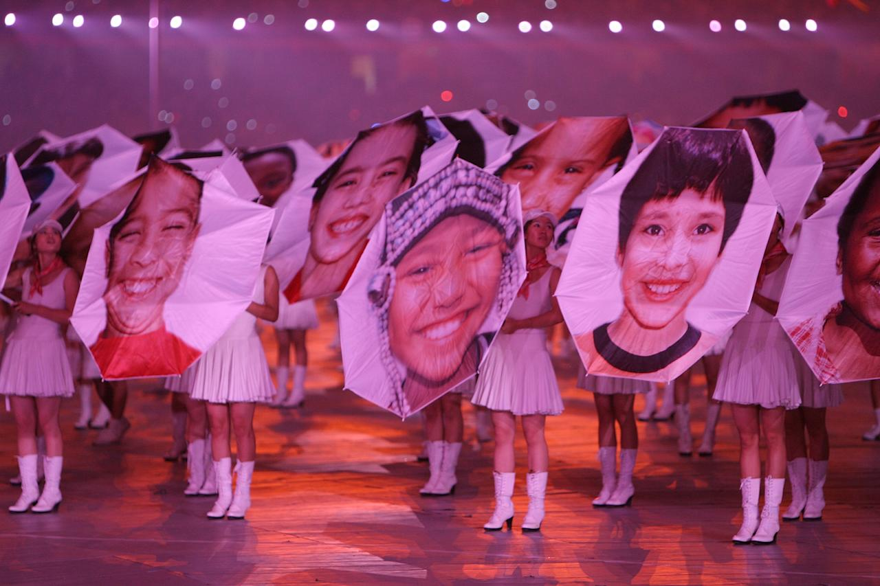 BEIJING - AUGUST 08: Performers display umbrellas with children's faces during the Opening Ceremony for the 2008 Beijing Summer Olympics at the National Stadium on August 8, 2008 in Beijing, China.  (Photo by Streeter Lecka/Getty Images)