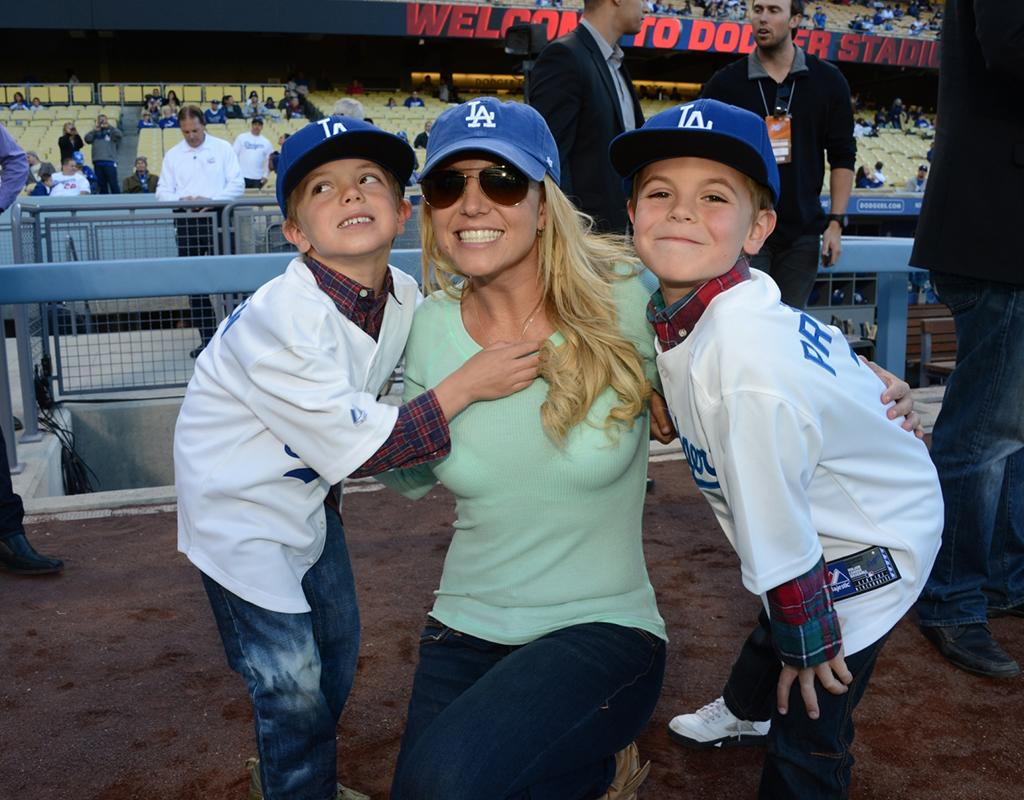 Britney Spears and her sons Jayden (L) and Sean were all smiles while posing at Dodgers Stadium in Los Angeles on Wednesday evening. (4/17/2013