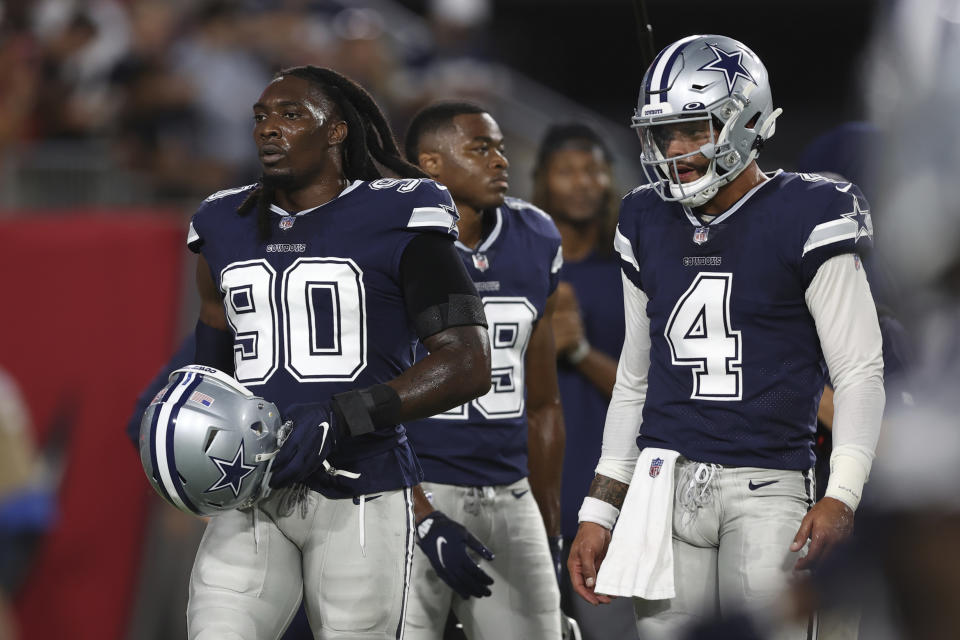 Cowboys defensive end DeMarcus Lawrence (90) is out for a reported 6-8 weeks with a broken foot, which he suffered at practice this week. (AP Photo/Mark LoMoglio)