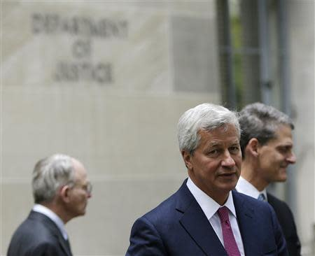 J.P. Morgan CEO Jamie Dimon (front) leaves the U.S. Justice Department after meeting with Attorney General Eric Holder, in Washington September 26, 2013. REUTERS/Gary Cameron