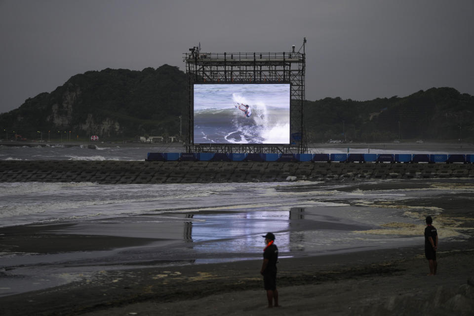 Lifeguards stand on the beach during the surfing competition at the 2020 Summer Olympics, Monday, July 26, 2021, at Tsurigasaki beach in Ichinomiya, Japan. The Olympic beach party that never was may be the only sore spot for surfing's long-awaited debut that finished triumphantly this week. (AP Photo/Francisco Seco)