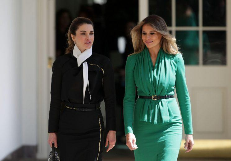 Melania Trump and Queen Rania of Jordon walk outside of the White House.