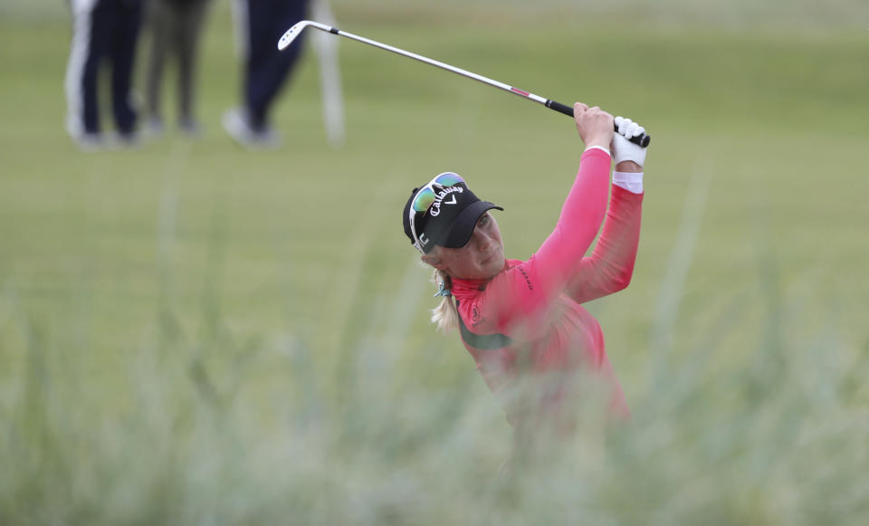 Sweden's Madelene Sagstrom plays a shot from the rough to the 18th green during the first round of the Women's British Open golf championship, in Carnoustie, Scotland, Thursday, Aug. 19, 2021. (AP Photo/Scott Heppell)