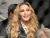 <p>Music recording artist Madonna watches the middleweight bout between Chris Weidman of the United States and Yoel Romero of Cuba during the UFC 205 event at Madison Square Garden on November 12, 2016 in New York City. (Photo by Jeff Bottari/Zuffa LLC/Zuffa LLC via Getty Images) </p>