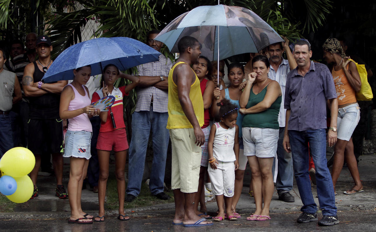 People wait for the arrival of the wedding couple; transsexual Wendy Iriepa and Ignacio Estrada, in Havana, Cuba, Saturday Aug.13, 2011. Iriepa, whose sex change operation was paid for by the state, tied the knot with Estrada in a first-of-its-kind wedding for Cuba. Gay marriage is not legal in Cuba and Saturday's wedding does nothing to change that since Iriepa is legally considered a woman. (AP Photo/Franklin Reyes)