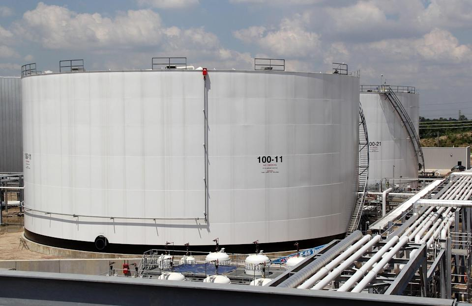 Two large oil tanks with pipelines connecting them