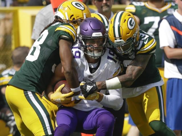 FILE - In this Sunday, Sept. 16, 2018 file photo, Minnesota Vikings' Adam Thielen catches a pass between Green Bay Packers' Tramon Williams and Jaire Alexander during the first half of an NFL football game in Green Bay, Wis. The game finished 29-29. The NFL reduced the length of overtime from 15 minutes to 10 before last season. (AP Photo/Jeffrey Phelps, File)