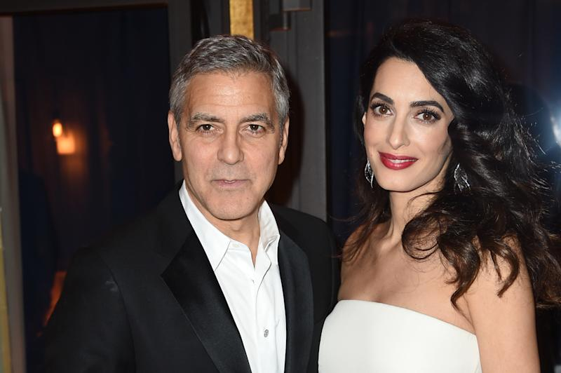 George Clooney and Amal Clooney pictured before the twins were born. (Stephane Cardinale - Corbis via Getty Images)