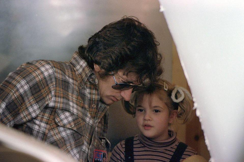 "<p>Director Steven Spielberg gives a young Drew Barrymore guidance during one of her first movie roles. The actress <a href=""https://www.imdb.com/title/tt0083866/trivia?ref_=tt_trv_trv"" rel=""nofollow noopener"" target=""_blank"" data-ylk=""slk:reportedly ad-libbed"" class=""link rapid-noclick-resp"">reportedly ad-libbed</a> her line, ""Give me a break!"" in the film.</p>"
