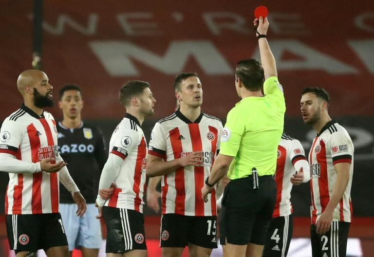Perfect 10 men: Phil Jagielka's (centre) red card did not cost Sheffield United