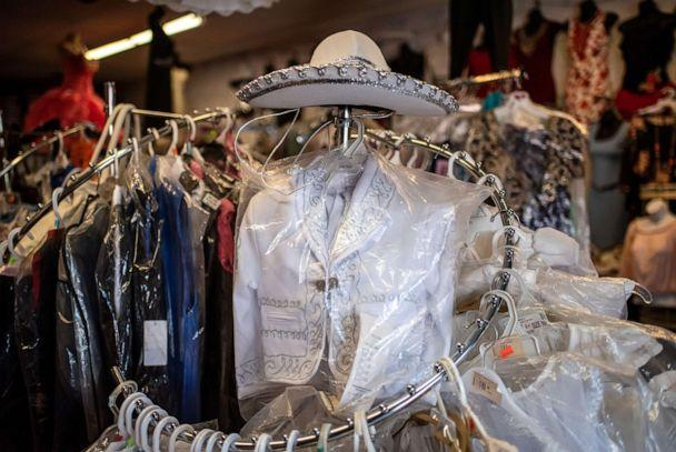 PHOTO: A mariachi outfit for a boy sits on display at Novedades Islas Fashion in Marshalltown, Iowa on Aug. 7, 2019. (Sergio Flores for ABC News)