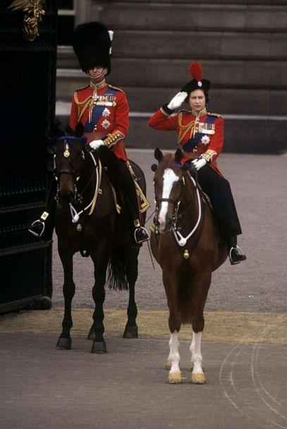 PHOTO: Queen Elizabeth II, accompanied by the Duke of Edinburgh, takes the salute outside Buckingham Palace at the conclusion of the Trooping the Colour ceremony, June 13, 1964. (PA Wire via ZUMA Press via Newscom, FILE)
