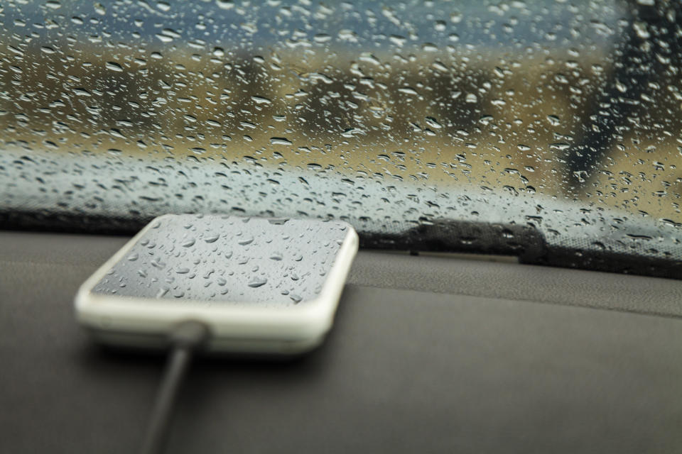 Cell phone is charging in the car (Getty)