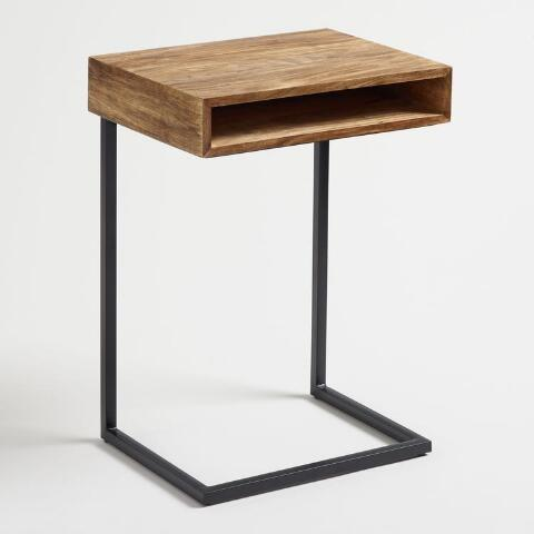 """<h3>World Market Laptop Table With Shelf</h3><br>For the most cramped of living spaces, this slim laptop stand has your compact desk-essentials-only needs covered (with a hidden shelf bonus, too).<br><br><strong>Cost Plus World Market</strong> Wood Alec Laptop Table with Shelf, $, available at <a href=""""https://go.skimresources.com/?id=30283X879131&url=https%3A%2F%2Fwww.worldmarket.com%2Fproduct%2Fwood-alec-laptop-table-with-shelf.do%3Fsortby%3DourPicks%26from%3Dfn"""" rel=""""nofollow noopener"""" target=""""_blank"""" data-ylk=""""slk:Cost Plus World Market"""" class=""""link rapid-noclick-resp"""">Cost Plus World Market</a>"""