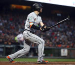 Miami Marlins' JT Riddle watches his two-run triple off San Francisco Giants' Dereck Rodriguez during the fourth inning of a baseball game Tuesday, June 19, 2018, in San Francisco. (AP Photo/Ben Margot)