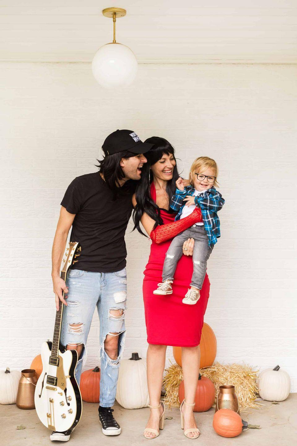 """<p>You'll be saying, """"Party time! Excellent!"""" in this throwback <em>Wayne's World</em> costume. We're loving this '<a href=""""https://www.countryliving.com/shopping/g23281444/90s-halloween-costumes/"""" rel=""""nofollow noopener"""" target=""""_blank"""" data-ylk=""""slk:90s"""" class=""""link rapid-noclick-resp"""">90s</a> look!</p><p><strong>Get the tutorial at <a href=""""https://abeautifulmess.com/2018/10/waynes-world-family-costume.html"""" rel=""""nofollow noopener"""" target=""""_blank"""" data-ylk=""""slk:A Beautiful Mess"""" class=""""link rapid-noclick-resp"""">A Beautiful Mess</a>. </strong></p><p><strong><a class=""""link rapid-noclick-resp"""" href=""""https://www.amazon.com/Amazon-Essentials-6-Pack-Crewneck-Undershirts/dp/B071GDV2B2/?tag=syn-yahoo-20&ascsubtag=%5Bartid%7C10050.g.29074815%5Bsrc%7Cyahoo-us"""" rel=""""nofollow noopener"""" target=""""_blank"""" data-ylk=""""slk:SHOP BLACK T-SHIRTS"""">SHOP BLACK T-SHIRTS</a><br></strong></p>"""