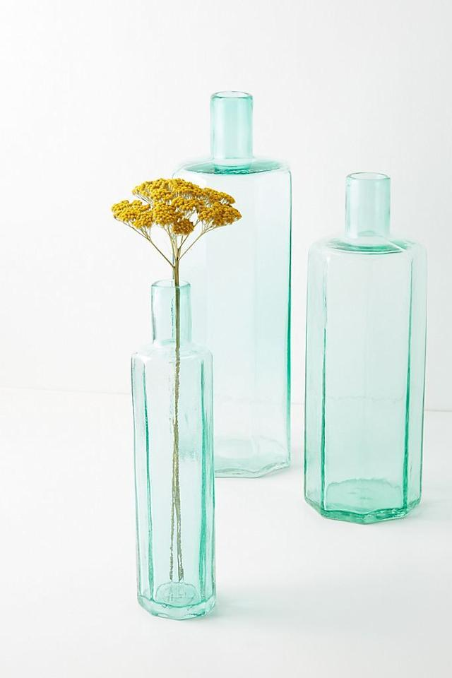 """<p><strong>Anthropologie</strong></p><p>anthropologie.com</p><p><a href=""""https://go.redirectingat.com?id=74968X1596630&url=https%3A%2F%2Fwww.anthropologie.com%2Fshop%2Fbottle-bud-vase2&sref=https%3A%2F%2Fwww.housebeautiful.com%2Fshopping%2Fbest-stores%2Fg34113028%2Fanthropologie-home-sale-50-off-fall-2020%2F"""" target=""""_blank"""">BUY NOW </a></p><p><strong><del>$48.00</del> $14.98</strong></p><p>Whether fresh or preserved, a single stem will look great in these handcrafted glass bottles.  </p>"""