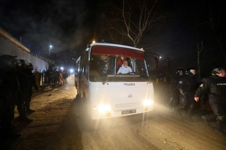 Protesters hurled hurl stones at vehicles carrying evacuees from China and bound for a medical facility in Novi Sanzhary