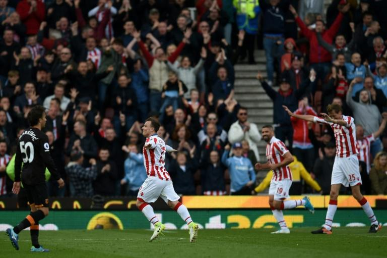 Stoke City's Xherdan Shaqiri (2L) celebrates scoring their third goal against Hull City at the Bet365 Stadium in Stoke-on-Trent, central England on April 15, 2017
