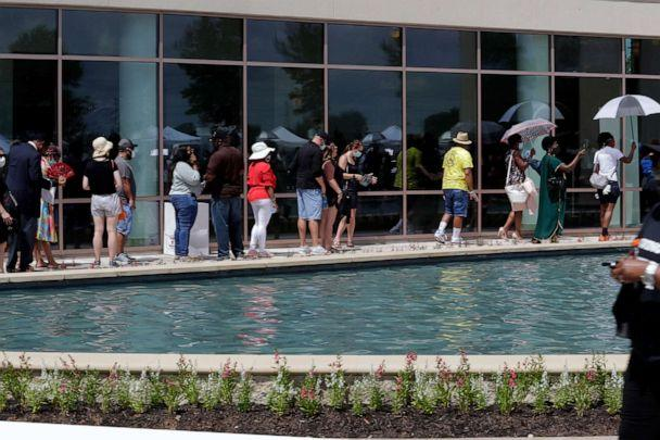 PHOTO: Guest line up outside for the visitation for George Floyd at the Fountain of Praise Church, June 8, 2020 in Houston. (Eric Gay/AP)