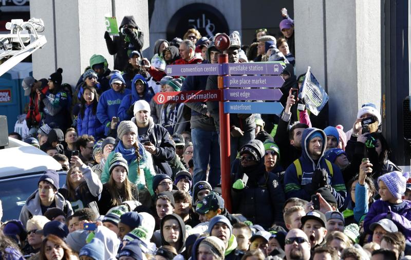 Seattle Seahawks fans cheer during the Super Bowl champions parade on Wednesday, Feb. 5, 2014, in Seattle. The Seahawks beat the Denver Broncos 43-8 in NFL football's Super Bowl XLVIII on Sunday. (AP Photo/Ted S. Warren)
