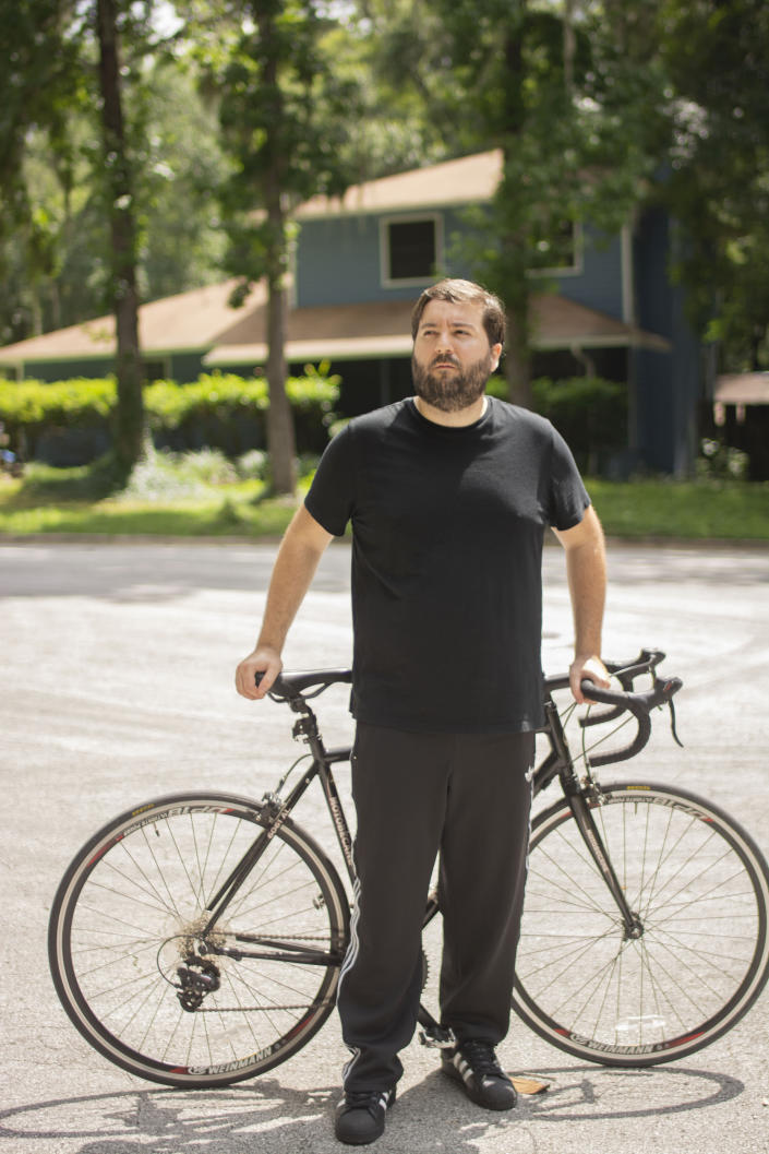 In this June 11, 2020, photo provided by Samuel Jones, his friend Zachary McCoy pauses on his bicycle in Gainesville, Fla. Local authorities considered McCoy a suspect in a house burglary because his Google location data showed he was near the house three times on the day the burglary occurred. McCoy said he rides his bike by the house regularly for exercise. Authorities were using geofence search warrants that allow law enforcement to gather data from Google on cellphone users and other devices near the scene of a crime. (Samuel Jones via AP)