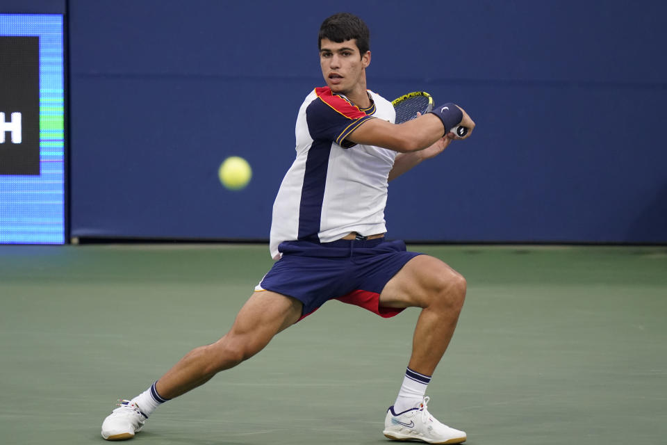 Carlos Alcaraz, of Spain, returns against Peter Gojowczyk, of Germany, during the fourth round of the U.S. Open tennis championships, Sunday, Sept. 5, 2021, in New York. (AP Photo/Frank Franklin II)