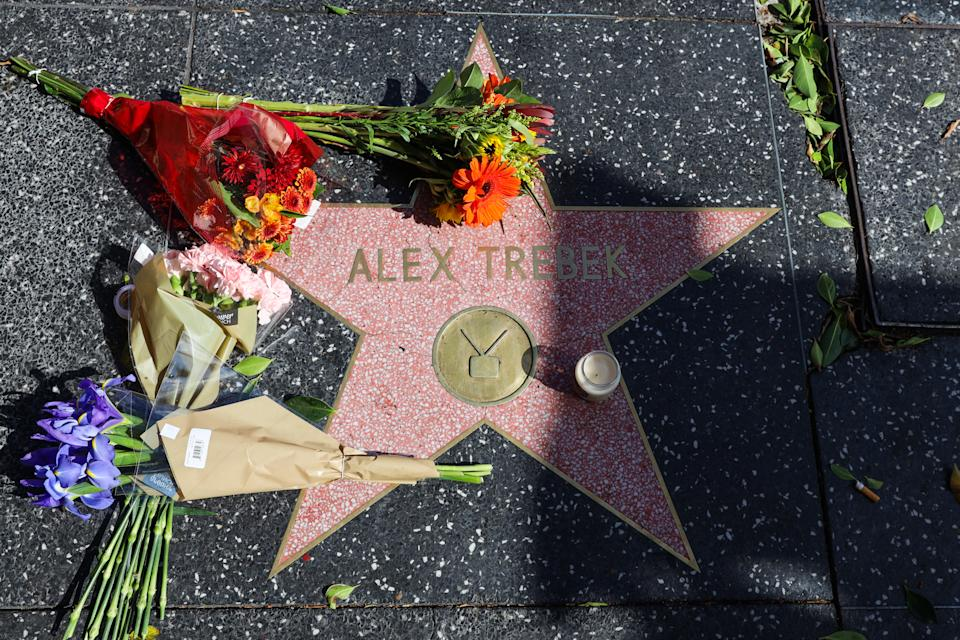 HOLLYWOOD, CALIFORNIA - NOVEMBER 08: Flowers are seen on Alex Trebek's star on the Hollywood Walk of Fame on November 08, 2020 in Hollywood, California. (Photo by Rich Fury/Getty Images)