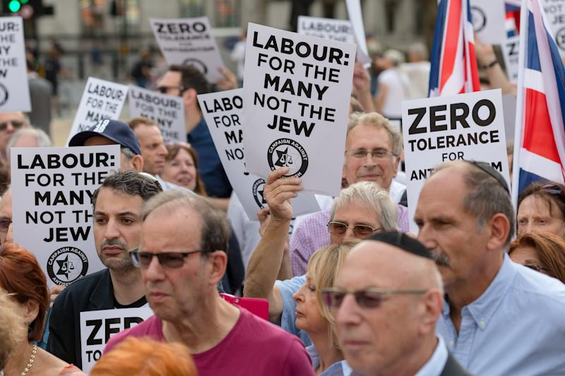 The campaign group, Campaign Against Antisemitism, Jewish community groups and their supporters stage a protest in Parliament Square, London, England on July 19, 2018 against the Labour Party anti-semitism code following the partys announcement that it will take action against Dame Margaret Hodge MP for calling Jeremy Corbyn an antisemite. (photo by Vickie Flores/In Pictures via Getty Images Images)