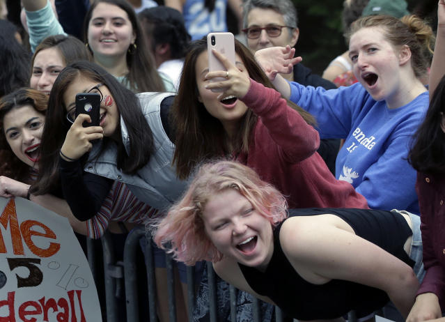 Wellesley College students cheer as runners from the 123rd Boston Marathon pass by on Monday, April 15, 2019, in Wellesley, Mass. (AP Photo/Steven Senne)