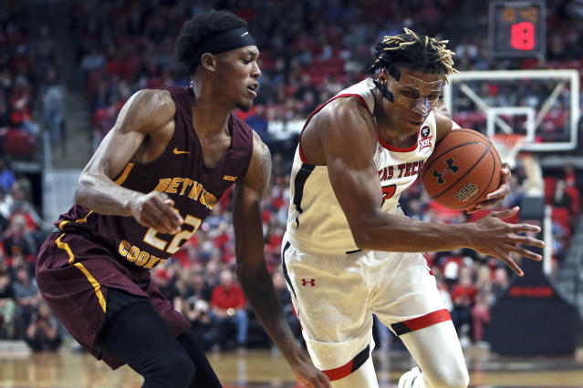 Texas Tech's Jahmi'us Ramsey (3) drives the ball past Bethune-Cookman's Isaiah Bailey (22) during the first half of an NCAA college basketball game Saturday, Nov. 9, 2019, in Lubbock, Texas. (Sam Grenadier/Lubbock Avalanche-Journal via AP)