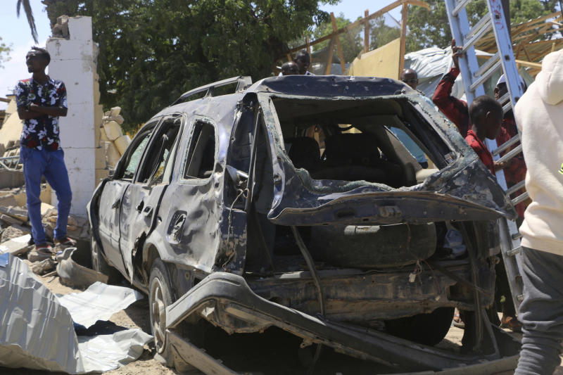A car destroyed during the attack at Asasey Hotel in Kismayo, Somalia after the attack Saturday July 13, 2019. Somali forces Saturday morning ended an all-night siege on a hotel in the southern port city of Kismayo, in which the death toll has risen to 26 people, including a prominent Canadian-Somali journalist and several foreigners, officials say.(AP Photo)