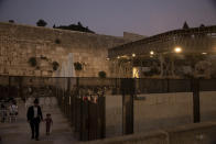 The wooden bridge, right, connecting the Western Wall, the holiest site where Jews can pray, to the Al Aqsa Mosque compound in Jerusalem's Old City, Tuesday, July 20, 2021. Experts say the rickety bridge that allows access to the Holy Land's most sensitive religious site is at imminent risk of collapse. But the shrine's delicate position at the epicenter of the Israeli-Palestinian conflict prevents it from being repaired -- raising fears of another disaster just months after 45 people were killed in a stampede at an ultra-Orthodox Jewish shrine where organizers had also ignored years of safety warnings. (AP Photo/Maya Alleruzzo)