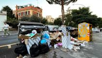 Volunteers sick of the filth have begun in recent years to organise periodic cleaning sessions -- but say the city should do its part (AFP/Vincenzo PINTO)