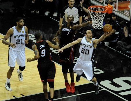 San Antonio Spurs guard Manu Ginobili (20) shoots against Miami Heat forward Chris Bosh (1) in game five of the 2014 NBA Finals at AT&T Center. Jun 15, 2014; San Antonio, TX, USA; Brendan Maloney-USA TODAY Sports