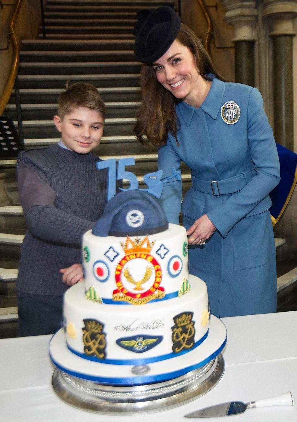 <p>Cake-cutting: Also a big royal duty. Kate did the honours during a celebration for the 75th Anniversary of the RAF Air Cadets London. And she wore a big fancy RAF pin on her coat. </p>