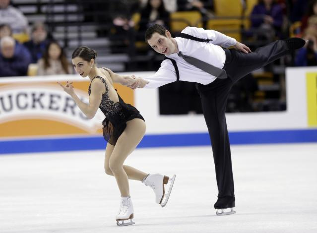 Marissa Castelli and Simon Shnapir compete during the pairs free skate at the U.S. Figure Skating Championships Saturday, Jan. 11, 2014 in Boston. (AP Photo/Steven Senne)