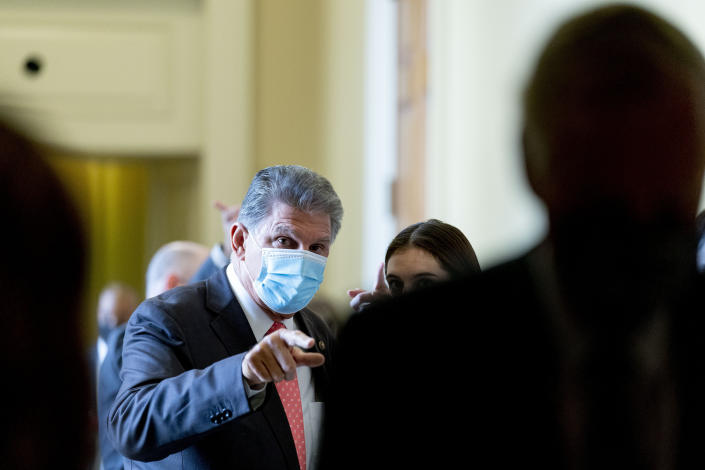 Sen. Joe Manchin speaks to an aide as he walks out of a Democratic policy luncheon in Washington, Tuesday, Sept. 14, 2021. (AP Photo/Andrew Harnik)
