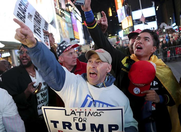Trump supporters in Times Square cheer news that he had won North Carolina. (Photo: Seth Wenig/AP)