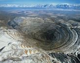 """<p>Over 100 years old, this copper mine includes a <a href=""""https://www.mining-technology.com/projects/bingham/"""" rel=""""nofollow noopener"""" target=""""_blank"""" data-ylk=""""slk:2.5-mile-wide pit"""" class=""""link rapid-noclick-resp"""">2.5-mile-wide pit</a> in the Oquirrh Mountains southwest of Salt Lake City, Utah. Considered the <a href=""""https://earthobservatory.nasa.gov/images/8144/bingham-canyon-mine-utah"""" rel=""""nofollow noopener"""" target=""""_blank"""" data-ylk=""""slk:largest man-made excavation"""" class=""""link rapid-noclick-resp"""">largest man-made excavation</a>, the mine dips nearly three-quarters of a mile down and covers 1,900 acres. First opened in 1906, the mine is still open and is a National Historic Landmark with a visitor center for folks who want to come and gawk at the hole in the ground that's required intricate planning throughout its decades of use.</p>"""