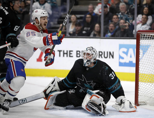 Montreal Canadiens' Andrew Shaw, left, celebrates after scoring a goal against San Jose Sharks goalie Martin Jones (31) during the second period of an NHL hockey game Thursday, March 7, 2019, in San Jose, Calif. (AP Photo/Ben Margot)
