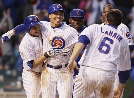 Chicago Cubs' Tony Campana, left, and Darwin Barney, second from left, celebrate with teammates after the Cubs defeated the Los Angeles Dodgers 4-3 in a baseball game in Chicago, Sunday, May 6, 2012. (AP Photo/Nam Y. Huh)