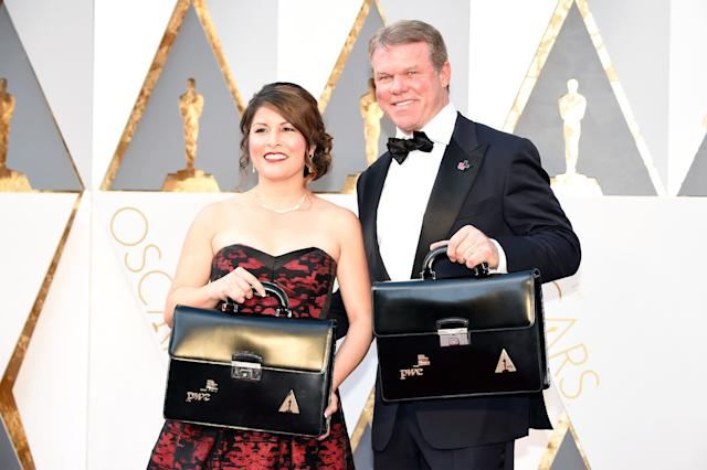 PricewaterhouseCoopers partners Martha Ruiz and Brian Cullinan attend the 88th Academy Awards at the Hollywood & Highland Center on Feb. 28, 2016, in Los Angeles.