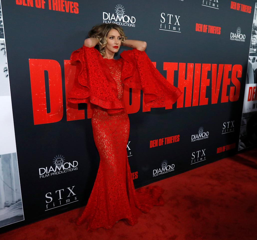 """Cast member Dawn Olivieri poses at the premiere for """"Den of Thieves"""" in Los Angeles, California, U.S., January 17, 2018. REUTERS/Mario Anzuoni"""