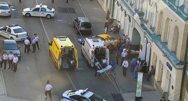 Ambulance and police attend the scene near Red Square in Moscow. (Via AP)