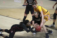 Stanford's Francesca Belibi, left, and Cameron Brink, center, battle for the ball against California's Sela Heide, right, during the first half of an NCAA college basketball game, Sunday, Dec. 13, 2020, in Berkeley, Calif. (AP Photo/Jed Jacobsohn)