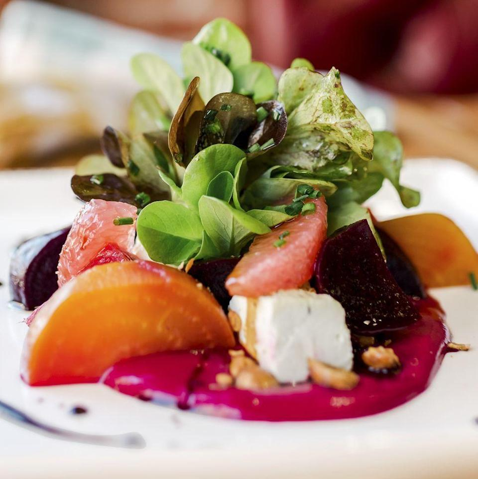 """<p>How festive does this jewel-toned salad look? The best part is that the yellow and red beets will taste as good as it looks. </p><p><strong><a href=""""https://www.thepioneerwoman.com/food-cooking/recipes/a33978589/roasted-beet-salad-recipe/"""" rel=""""nofollow noopener"""" target=""""_blank"""" data-ylk=""""slk:Get Ree's recipe."""" class=""""link rapid-noclick-resp"""">Get Ree's recipe.</a></strong></p>"""